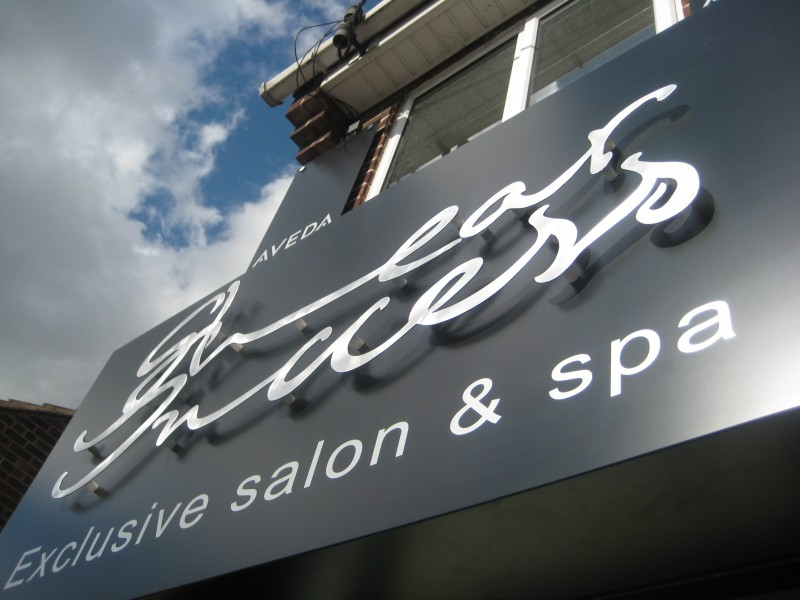 Salon sign in mixed printed and aluminium lettering